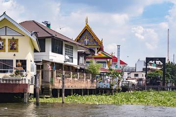 houses on stilts along the river in Bangkok