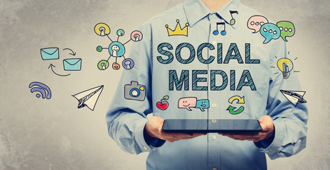 Social Media concept with young man holding