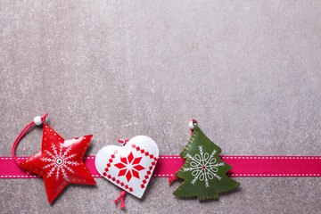 Christmas decorations   and ribbon on  grey slate  background.