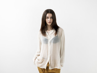 Beautiful girl portrait wearing white transparent blouse