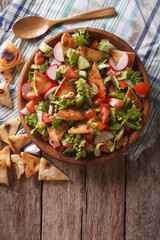 Traditional Arabic fattoush salad on a plate. vertical top view