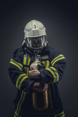 Rescue firefighter in safe helmet and uniform.