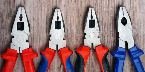 pliers on wooden background