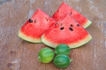 sliced fresh red watermelon and small watermelon.