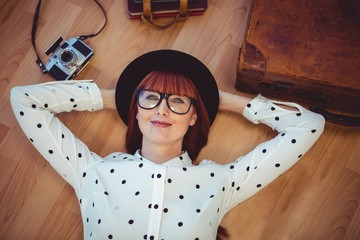 Attractive hipster woman lying on the floor