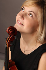 the young cheerful beautiful girl the musician playing a violin
