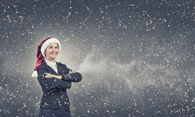 Businesswoman in Santa hat