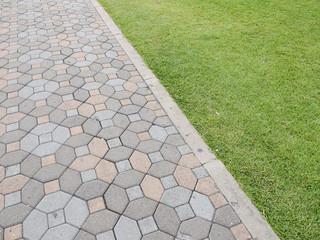 Brick walkway with grass