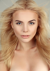 beautiful young woman with blond hair and glowing skin