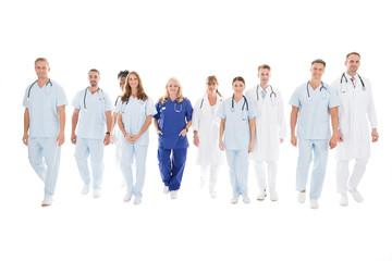 Confident Multiethnic Medical Team Walking In Row