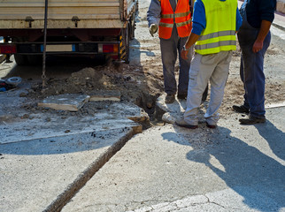 Workers during the construction of the broadband network with fiber glass in a city street
