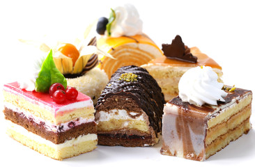 Foto auf Acrylglas Desserts Assorted different mini cakes with cream, chocolate and berries
