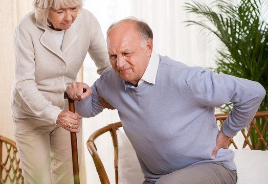 Elderly man having a back pain