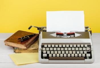 Typewriter with sheet of paper