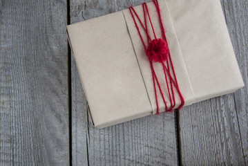 Christmas gift box handicraft wrapping, parchment, twine. Top view.