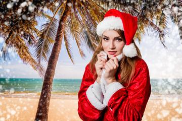 Buitiful girl dressed like Santa Claus