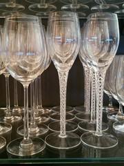 Wine and Champagne Stemmed Glasses Line Up on Shelf