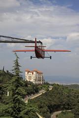BARCELONA, CATALONIA, SPAIN - AUGUST 29, 2012: Red aeroplane and Gran Hotel La Florida near Tibidabo, Barcelona,Catalonia, Spain