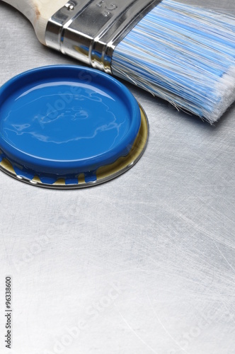 "Darkbluepaintbrush: ""Blue Paint Can Lid With Brush On Grey Metal Background"