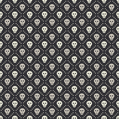 Vector seamless pattern with small skulls and dots