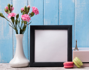 Blank frame, pink flowers and macarons.
