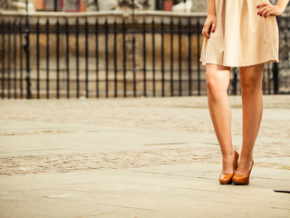 Fashion. Female legs in stylish shoes outdoor