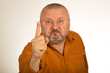 An angry man with beard pointing finger at you