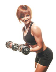 Young fit woman doing dumbbell curls