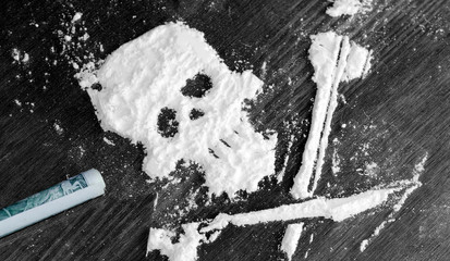 Drug powder cocaine in the silhouette of the skull