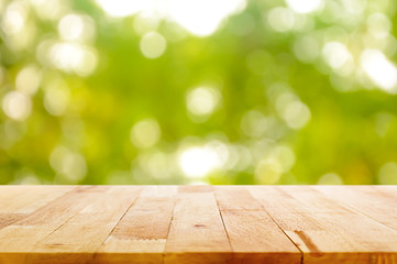 Wood table top on natural green bokeh abstract background