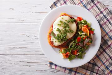 Italian chicken Parmigiana and salad. horizontal top view