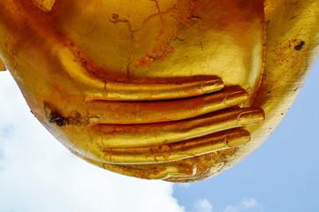 golden Buddha hand hold an alms bowl