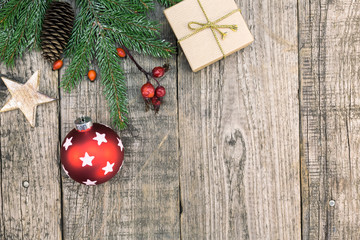 christmas star and decoration over wood background