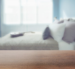 wooden table top with blur interior of modern interior decoratio