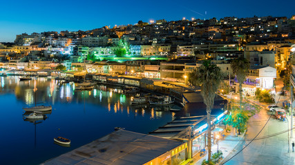 Mikrolimano port in Peraeus Greece against the city lights.