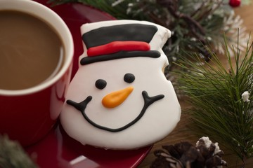 snowman cookie and coffee cup