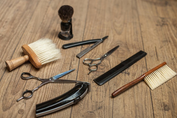 Professional equipment on wooden surface at hair salon