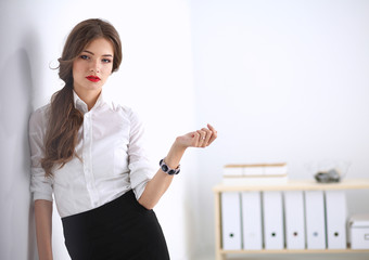 Attractive businesswoman standing in office