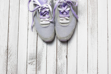 Pair of sport shoes on white wooden background