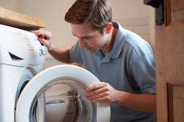 Engineer Mending Domestic Washing Machine