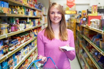 Portrait Of Woman In Supermarket With Shopping List