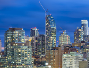 Skyscrapers and new  high-rise building sites  in  Downtown Toronto after  sunset
