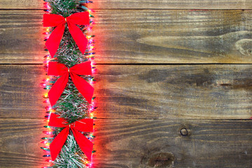 Blank rustic sign with Christmas garland border