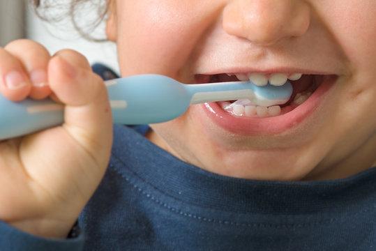 detail of a child washing teeth