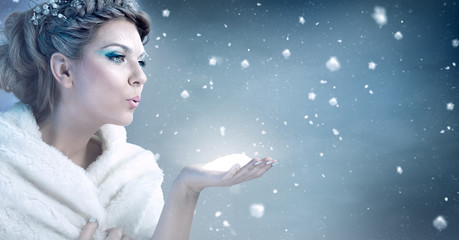 Winter woman  blowing snow - snow queen