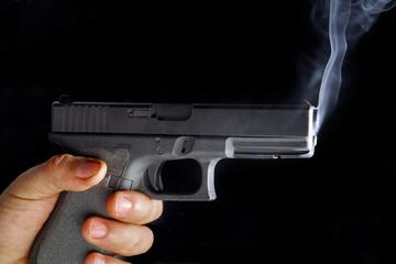 Male hand with a gun