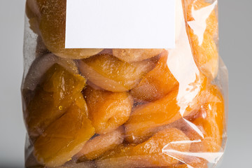 Macro of candied apricots in luxury plastic bag