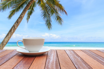 White coffee cup on wood table and view of nature background