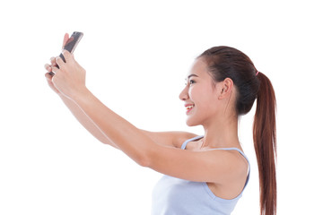Happy young woman taking a selfie using her smartphone