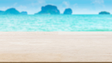 Wood table top on blured sea and sky : Can use for montage or display your product.